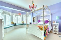 What a cute colorful bedroom!   Check our more photos of this house by visiting: http://www.houzz.com/projects/226685/Graham-Hill-Residence