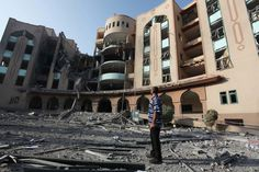 A Palestinian man observes the damage at the Islamic University of Gaza on 2 August after it was hit in an overnight Israeli strike.