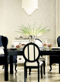 Beautiful dining room.  The black and white scheme is very elegant.