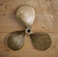 Boat Propeller  - Antique Brass; leaning against a wall or bookcase