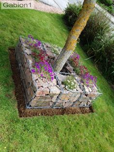 gabions with flower inserts make this garden feature hpp://www.gabion1.co.uk
