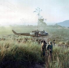 A Huey takes off after unloading some troops. ~ Vietnam War