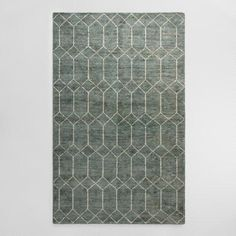 Handcrafted by artisans with a distressed and sheared pile for a vintage look, our exclusive rug features a geometric gate pattern with a striking dimension. Its low-profile construction and faded blue-green background make it easy to slip into any decor setting. 9 x 12 $340