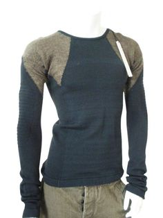 Crewnecked sweater in wool with inlays on the shoulders in different color, seam on the centre back.   Price $191.00