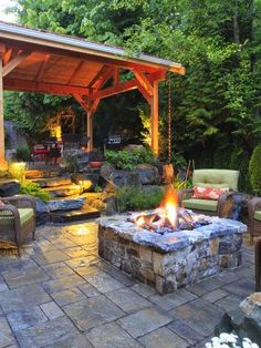 Lovely transition from covered patio/bbq area to fire pit seating.