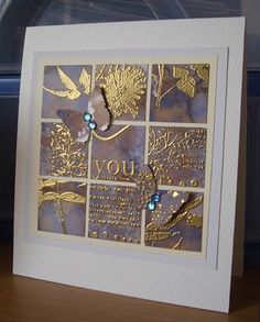 Gold embossing powder with alcohol ink background