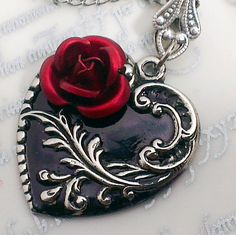 Could be done with black resin, metallic acrylic paint and a rose cabochon