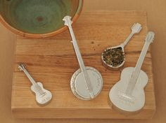 Fine tune any recipe with this great set of measuring spoons. The acoustic guitar measures the tablespoon, its about four inches tall. The