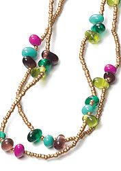 Long gold colour beaded necklace with lentil beads