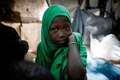 For all of her eleven years, Hajiya Mohamed has grown-up in war. She lives in Mogadishu's Shabelle 1 IDP camp.  Photo by Phil Moore