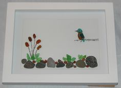 Sea glass kingfisher by a river with bull rushes.