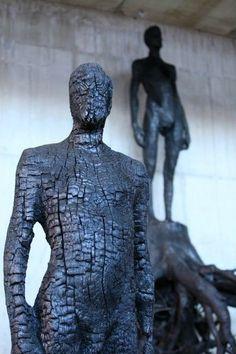 Carved  charred figures by Italian artist  sculptor Aron Demetz (b.1972). via Furniture