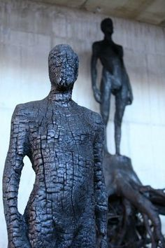 Carved & charred figures by Italian artist & sculptor Aron Demetz (b.1972)