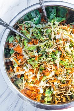 Crunchy Napa Cabbage Asian Slaw. A salad full of fresh and crunchy vegetables and drizzled with a creamy ginger soy dressing, this satisfying summer salad is a quick and easy go to!
