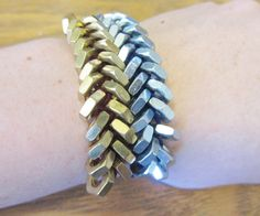 I'm married to an engineer (check him out http://www.instructables.com/member/vreinkymov/) , so all sorts of washers and hex nuts are always laying about the house from his various projects. I've always thought hex nuts were pretty and decided to make a simple braided bracelet with them. I thought I was so clever until I searched the internet and found that everyone and their mother had a tutorial on it. Oh well, here it goes!