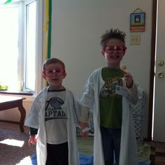 Science costumes for birthday party. 'lab coats' using a white tshirt cut down the middle, dollar store glasses with white tape in the middle and nametags for official flare. oh and crazy mad scientist hair