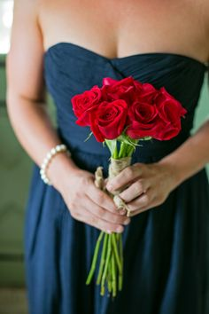 Red, white and blue inspired wedding. :: Blue bridesmaid dress with red rose bouquet.