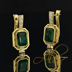 EDC557 - Custom made lever-back Emerald earrings are crafted in 18K yellow gold and are accented by 0.41 ctw in prong set diamonds for an elegant every day look.