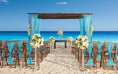 Stylish AMResorts All Inclusive Cancun Beach Tiffany Blue Wedding Ceremony Decorations. At Weddings Romantique, we will be glad to help you plan your Stylish AM Resorts Destination Weddings, we will take care of your destination wedding services from sourcing the right vendors, creating a stylish event that reflect your personality and budget to all the legal requirements for getting married on away from home.