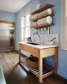 Unfitted kitchens use a furniture approach and often includes freestanding sinks like this one from the Smallbone of Devizes Brasserie line.