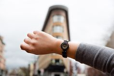 This women's wood watch shows hourly markers on a round face, and has an elastic band with heart-shaped wood beads. The Maria Watch is made from 100% recycled and reclaimed wood, with stainless steel