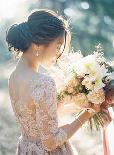 Gorgeous natural bouquet  Jen Huang Photography Pronovias Wedding Gown Camellia Floral Design Chiali Meng Artistry Davia Lee Events Oak Grove Wedding in Santa Barbara