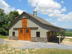 Pleasure barn featuring shingle roof, custom cupola, hardie siding, cedar doors, and stone veneer