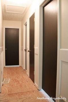Painting interior doors dark chocolate brown.  Great way to update plain hollow core doors. I plan to add molding later on.