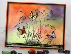 Charlene Driggs:  Rubbernecker Floral #10 and Butterfly Inchies; Versafine Onyx Black; May Arts Black Twine; black Stickles; watercolor background