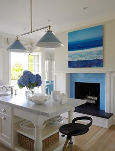 love the ocean photo and blue tile on fire place