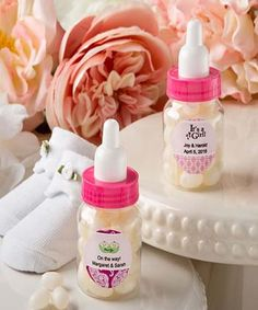 Personalized expressions baby girl bottle favor with white jelly bean candy - Add the cutest touch to your event tables and delight your guests with these charming little bottles. They have clear plastic bottoms with pink screw lids and white plastic nipple tops. http://www.favorfavorbaby.com/p-9602ST_Baby.htm
