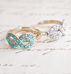 Bow Ring... love the turquoise.  It's my birthstone and hard to find in a setting I like.  This is so delicate.