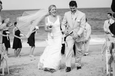 This fun loving couple's big day was a picture perfect afternoon in the Outer Banks that led into a most amazing evening of dining and dancing under the stars. See more of this navy and yellow wedding on our blog! Photo by Coastal Shots