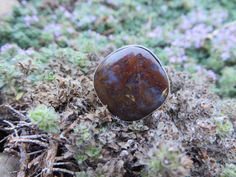 This is a red moss agate by Sandy River Jewelry, it is #373, size 7 1/4
