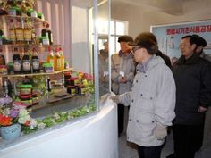 Kim Jong-Il looking at things.