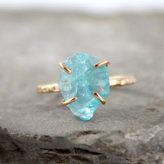 This is beautiful! It is a raw uncut rough Apatite; handmade. The ring is 14c gold filled, textured to match the rough and natural look of the stone. by asecondtime at Etsy.