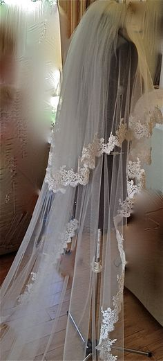 Lace Veil, two tiers, cathedral length, classic look with blusher,  accept custom orders. $290.00, via Etsy.