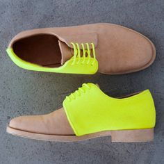 These mens shoes have a funky color palate of a neutral tan and a bright bold neon yellow. Neutrals with pops of neon can also be found in accessories and jewelry. Emily W.