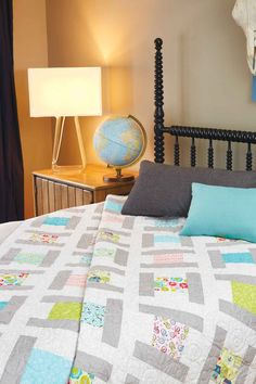"This geometric quilt highlights a collection of pre-cut 5"" squares. City Blocks is a great throw quilt pattern that shows off a secondary design!"
