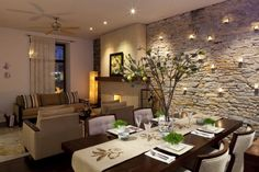 I like the candles against the stone - and how the wall splits up the living spaces.