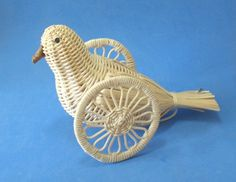 Weird and Wacky Woven Wicker Bird on Wheels by whispermystery