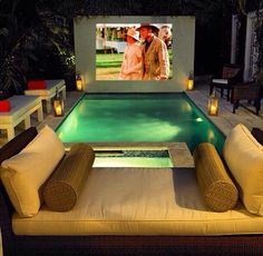 I would totally build this pool setup if I was rich and the pool was heated. Movie projector in the backyard is totally doable.