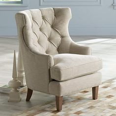 This tufted oatmeal fabric high-back accent chair is a quietly fabulous transitional accent that will soften any room.