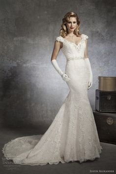 Style 8654 cap sleeve beaded V-neck mermaid gown in Venice lace with beaded belt by Justin Alexander.