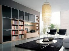 Awesome Living Room Design With Wooden Wall Open Storage Bookshelves And White Gloss Round Acrylic Coffee Table Using Metal Base And Double Black Chairs On Area Dim Gray Rug As Well As Wonderful Pendant Lamps, Inspiring Creative Of Beautiful Contemporary Living Room Decorating Ideas: Furniture, Interior, Living Room