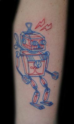 This awesome anaglyph 3D tattoo of a wind-up toy robot was conceived and created at Joker The Tattoo Shop in Turku, Finland. It was created and inked by Tuula joka piirtää for a client who has been obsessed with robots for as long as they can remember.   [via Juxtapoz]