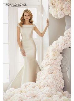 Add some old fashioned Hollywood glam to your wedding dress by choosing this stunning off the shoulder satin gown from Ronald Joyce