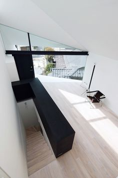 This unique structure in Tokyo is a smart renovation of a traditional Japanese home. Called simply Arrow, the renovation features a second floor living space accessed by a dramatic entrance staircase. The existing structure on the ground floor has been transformed into a photography studio. A unique skylight and floor-to-ceiling windows flood the home with soft, natural light.