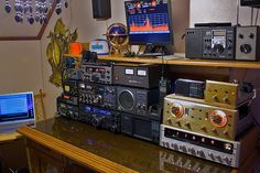 An old ham's radio setup...it covers just about everything you could need, SW, AM, FM, CB, UHF, VHF, antenna switches, backup power, watt and amp meters and monitors.