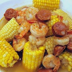 Frogmore Stew .... water, old bay seasoning, salt, potatoes, spicy sausage, ears of corn, shrimp, butter    http://www.bigredkitchen.com/2008/09/watched-pot-never-boils-frogmore-stew.html